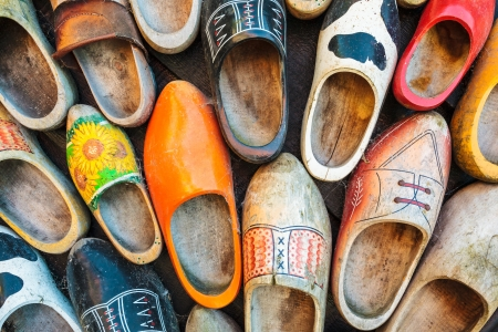 Set of different colorful vintage Dutch wooden clogs photo