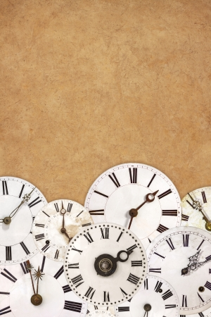 timezone: Set of different vintage white clock faces on an ancient brown background