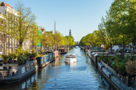Summer view of houseboats on the Dutch Prinsengracht canal in Amsterdam