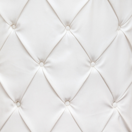 White leather texture with buttons in a pattern photo