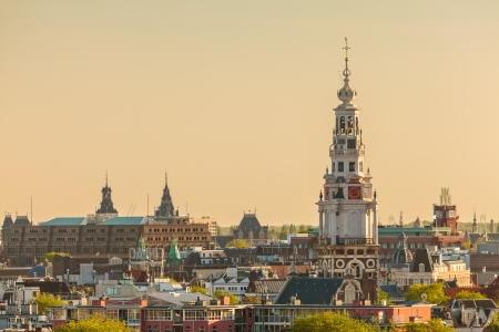 holland landscape: Evening view of the Amsterdam city center with the famous Zuiderkerk church located on the right Stock Photo