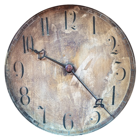 Vintage weathered and dirty clock face isolated on a white background photo