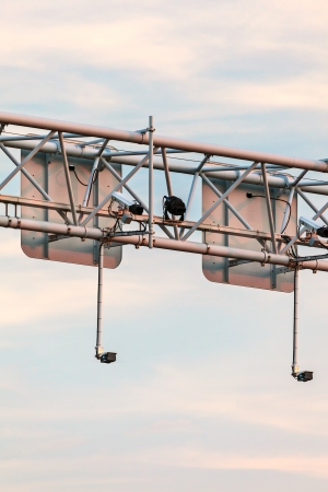 Surveillance camera system above a Dutch highway during sunset photo
