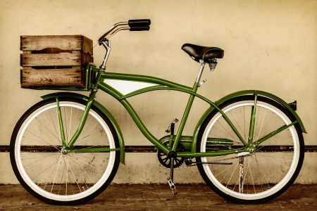 Retro styled sepia image of a vintage beach cruiser bicycle with wooden crate photo