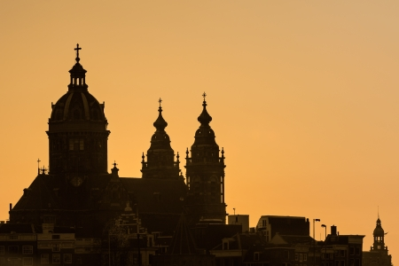 nicolaas: Silhouette of the medieval Dutch Nicolaas basilica in the city centre of Amsterdam Stock Photo