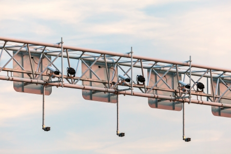 big brother spy: Surveillance camera system above a Dutch highway during sunset