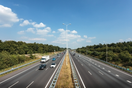 multiple lane highway: Multiple lane highway in The Netherlands against a blue sky with few clouds Editorial