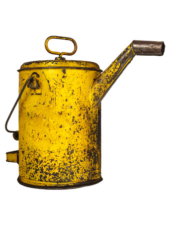 lubricator: Vintage yellow lubricant oil can isolated on a white background Stock Photo