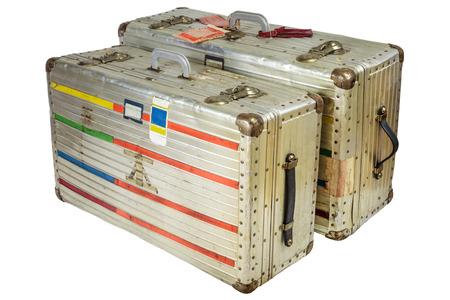 antique suitcase: Two retro aluminum flight suitcases isolated on a white background Stock Photo