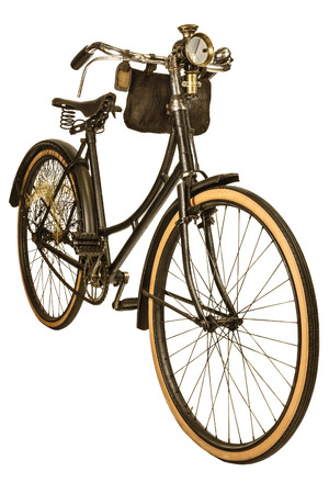 bicycle wheel: Retro styled image of a nineteenth century bike with lantern isolated on a white background