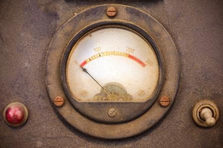 Vintage dusty volt meter in a black metal casing photo