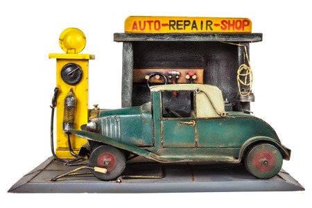 car repair shop: Retro toy car repair shop isolated on a white background Stock Photo