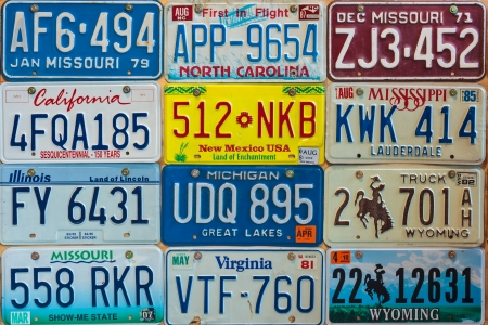 numberplate: DREMPT - NOVEMBER 15  Vintage car license plates on a wall on November 15, 2013 in Drempt, The Netherlands  In the U S  each state issues its own car number plates