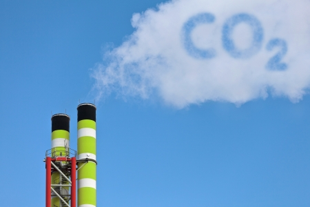symbolic: Green factory pipes with symbolic emission of a co2 cloud