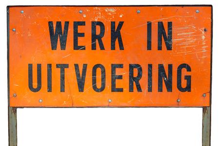 白い背景に分離した工事看板の下でオランダのオレンジ 写真素材