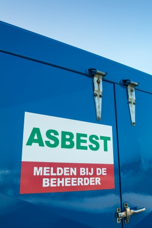 signage outdoor: Dutch asbestos sign on a blue container used for safe storage of the toxic asbestos material