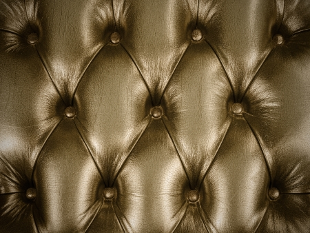 Retro styled image of an old vintage couch with buttons photo