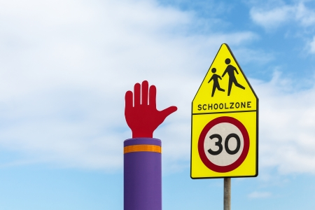 city limit: School zone warning road signs against a blue sky in The Netherlands Stock Photo