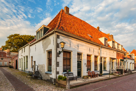 dutch typical: Typical Dutch row of medieval town houses in Elburg The Netherlands during sunset Stock Photo