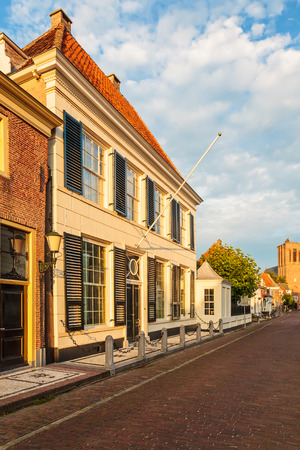 Typical Dutch medieval town house in Elburg The Netherlands during sunset photo