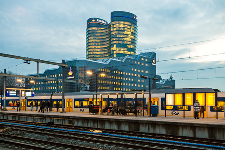 utrecht: UTRECHT, THE NETHERLANDS – JANUARY 30, 2014  Utrecht central train station with the Dutch international Rabobank Group headquarters situated in the background Editorial