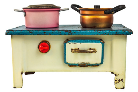 doll house: Vintage doll house cooking stove with pans isolated on a white background