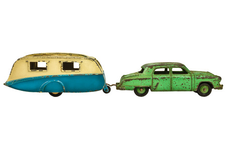 rusty car: Vintage toy car with classic caravan isolated on a white background