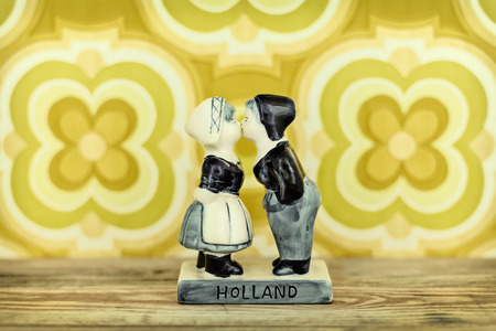 Retro styled image of a traditional Dutch souvenir with kissing boy and girl photo