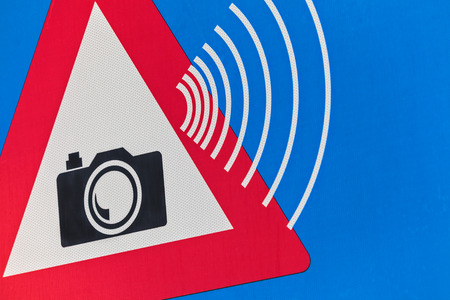 Detail of a Dutch traffic sign with speed camera warning photo