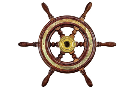 Vintage wooden ship steering wheel rudder isolated on a white background photo