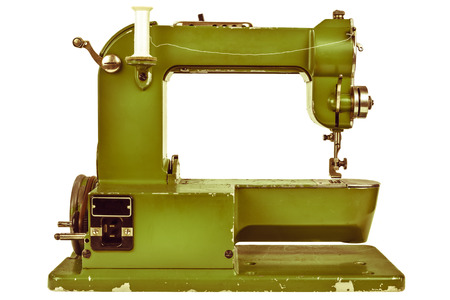 Retro styled image of an old sewing machine isolated on a white background photo