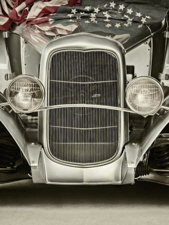 car grill: Retro styled image of a classic hotrod car with the American flag on the hood