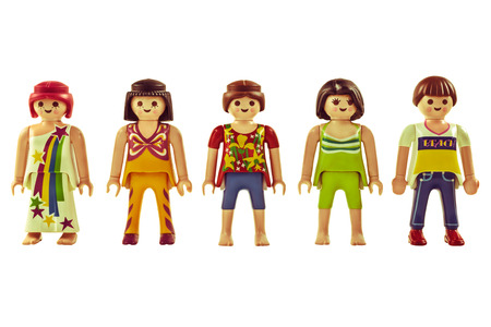 DIEREN, THE NETHERLANDS - APRIL 30, 2014  Retro styled studio image of vintage Playmobil puppets with flower power clothing isolated on a white background
