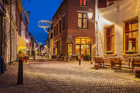 Evening view of the famous Walstraat in the Dutch historic city centre of Deventer