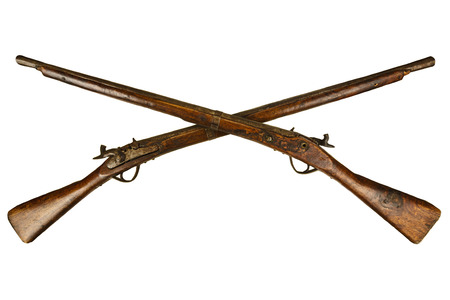 Two crossed vintage wooden rifles isolated on a white background