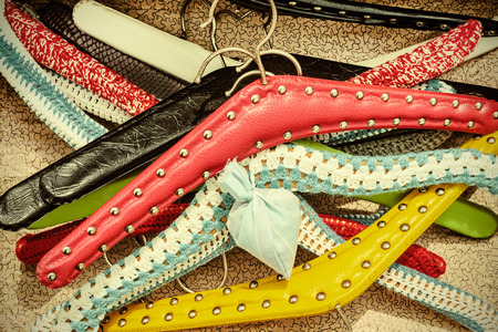 coat hanger: Retro styled image of various colorful vintage dress hangers