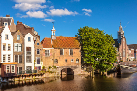 rotterdam: Summer view of medieval houses alongside a canal in Delfshaven, The Netherlands