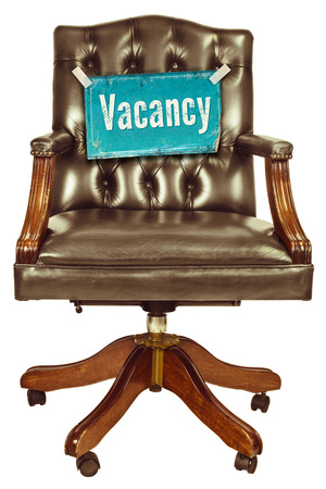 vacant: Retro office chair with vacancy sign isolated on a white background Stock Photo