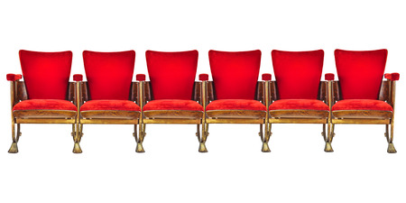 Row of six red vintage cinema chairs isolated on a white