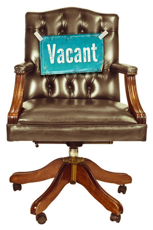 vacant: Retro office chair with vacant job sign isolated on a white