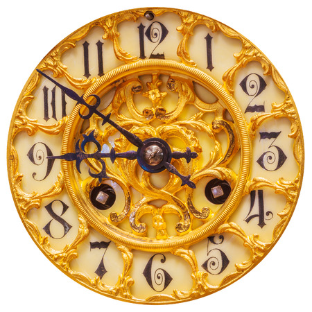 Rich decorated ancient golden clock face isolated on a white background