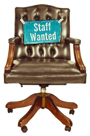 vacant: Retro office chair with staff wanted sign isolated on a white background Stock Photo