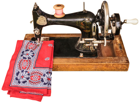 stitching machine: Old sewing machine with classic red cloth isolated on a white background Stock Photo