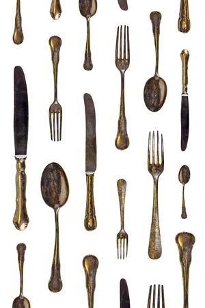 Pattern of vintage spoons, knives and forks isolated on a white background photo