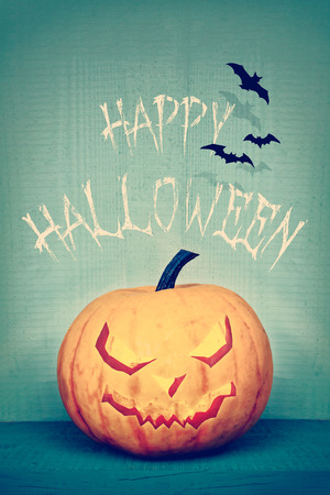 vintage halloween: Retro styled image of a pumpkin with Happy Halloween greeting Stock Photo