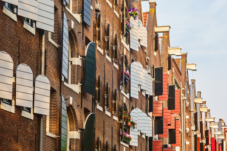 Row of ancient warehouses in the city of Amsterdam photo