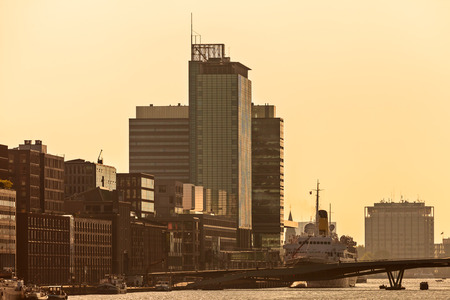 Sunset view of Amsterdam with modern buildings alongside the river IJ photo