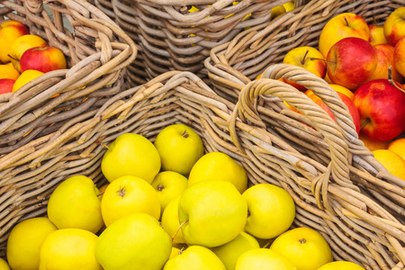 golden apple: Wicker baskets with fresh apples Stock Photo