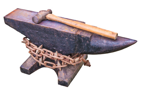 ancient blacksmith: Vintage rusty anvil with chain and hammer isolated on a white background