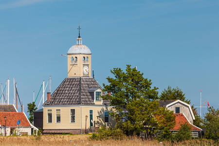 Classic wooden church and houses in the small Dutch village of Durgerdam near Amsterdam photo